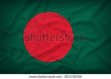 Bangladesh flag on the fabric texture background,Vintage style - stock photo