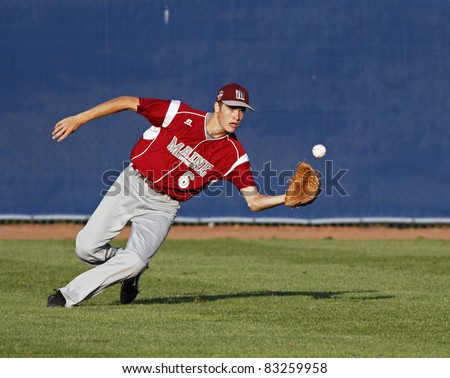 BANGOR, MAINE - AUGUST 18: Centrefielder Spencer Valley of Maine (Brewer/Orrington) tracks a fly ball at the Senior League Baseball World Series August 18, 2011 in Bangor, Maine. - stock photo