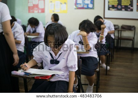 BANGPROK PATHUMTANI THAILAND SEPTEMBER 2016 :Unidentified students are quiz on the exam sheet on September 15,2016 in Bangprok Muang Patumtani Thailand.