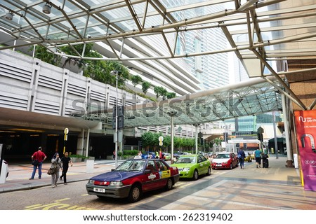 Bangsar, KUALA LUMPUR - March 21, 2015: Taxis lined up waiting to take passengers at KL Sentral, KUALA LUMPUR. Taxis and rental cars rose between 20 and 67 per cent with immediate effect. - stock photo
