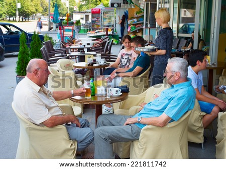 BANJA LUKA, BOSNIA AND HERZEGOVINA - JULY 28, 2014: People at a street restaurant in Banja Luka. Banja Luka is the second largest city in Bosnia and Herzegovina , famous tourists attraction. - stock photo