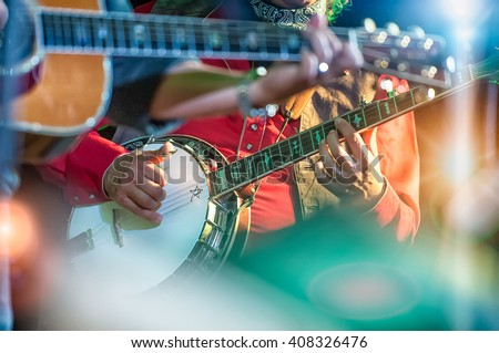 Banjo player in the country band - stock photo