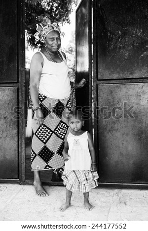 BANJUL, GAMBIA - MAR 14, 2013: Unidentified Gambian grandmother and grand daughter in Gambia, Mar 14, 2013. Major ethnic group in Gambia is the Mandinka - 42% - stock photo