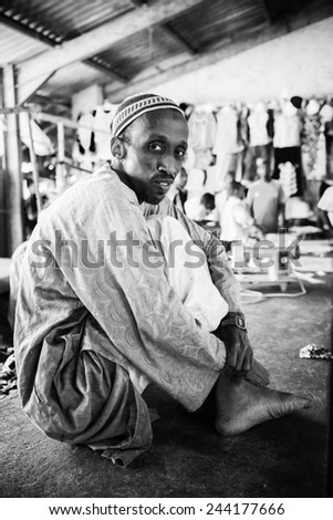 BANJUL, GAMBIA - MAR 14, 2013: Unidentified Gambian old man sits in Gambia, Mar 14, 2013. People of Gambia suffer of poverty due to the unstable economical situation
