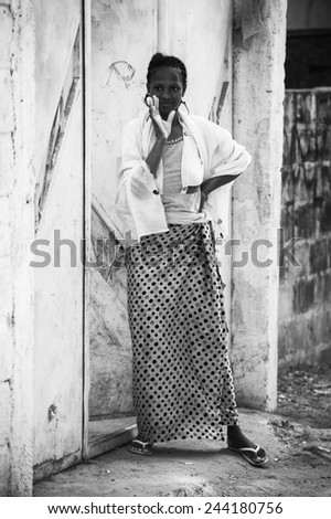 BANJUL, GAMBIA - MAR 14, 2013: Unidentified Gambian woman says hello in Gambia, Mar 14, 2013. Major ethnic group in Gambia is the Mandinka - 42% - stock photo