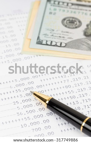 Bank account passbook with pen and dollar banknote