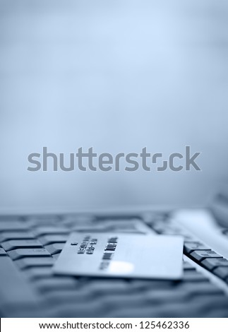 Bank Credit Card on a Computer Keyboard - stock photo