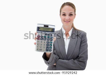 Bank employee showing her pocket calculator against a white background - stock photo