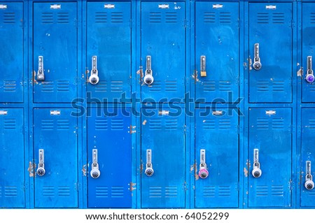 Bank of beat up blue school lockers - stock photo