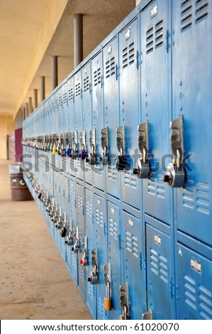 Bank of school lockers with colorful locks.