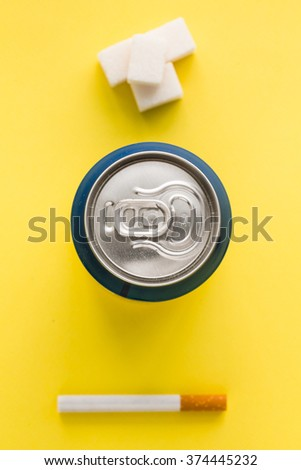Bank of soda and sugar cubes on a bright background - stock photo