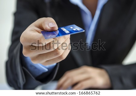 Bank office worker providing credit card