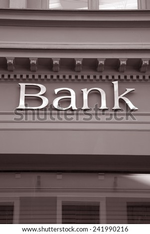 Bank Sign on Branch Facade in Black and White Sepia Tone - stock photo