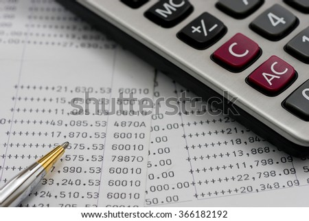 bank statements with pen and calculator