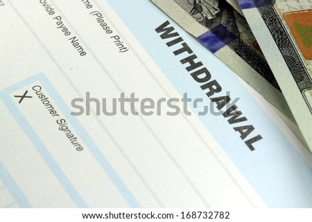 Bank withdrawal slip with US currency - stock photo