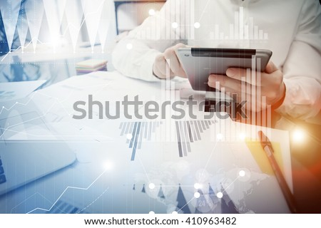 Banker manager working process.Trader work market report modern tablet.Using electronic device.Graphic icons,exchange report,worldwide stock exchanges interface.Business startup.Horizontal,film effect - stock photo