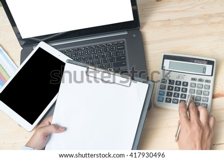 Bankers calculations Savings, finance and the economy. - stock photo