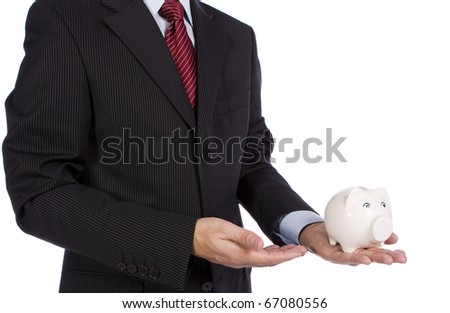 Banking concept - A businessman showing a piggy bank - stock photo