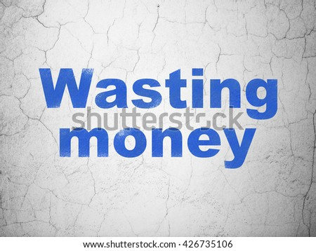 Banking concept: Blue Wasting Money on textured concrete wall background