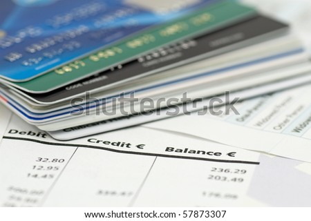 banking expenses, credit cards on bank invoice. very shallow DOF - stock photo