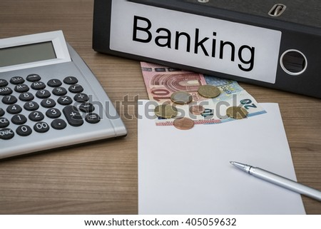 Banking written on a binder on a desk with euro money calculator blank sheet and pen - stock photo