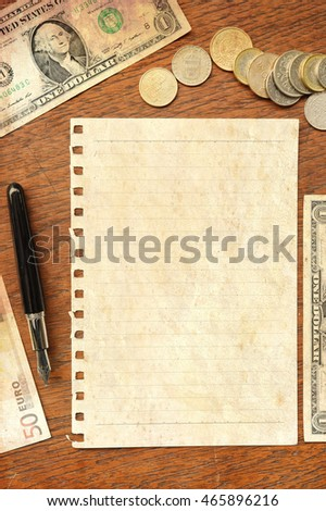 banknote and coins with paper for background with sunlight vintage color