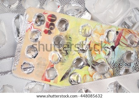 Banknote 50 Bermuda dollars on an empty blister pack of tablets - stock photo