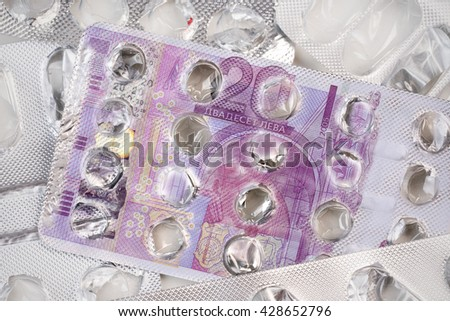 Banknote 20 Bulgarian levs on an empty blister pack of tablets - stock photo