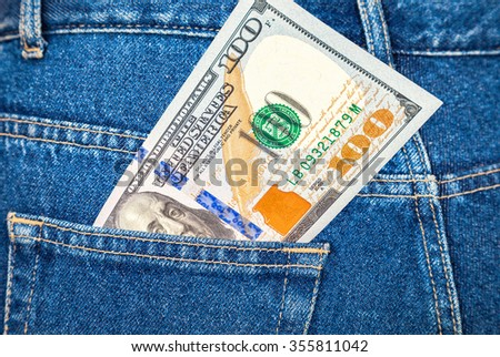 Banknote of one hundred american dollars in the back jeans pocket - stock photo