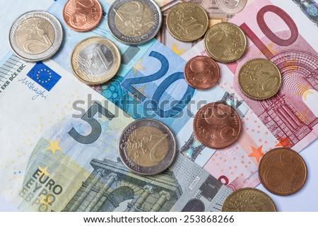Banknotes and coins of euro currency as background