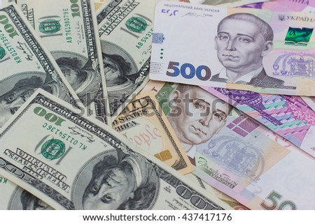 banknotes, clear image of dollars and new bills Ukrainian national currency hryvnia. naminal hundred and five hundred hryvnia - stock photo