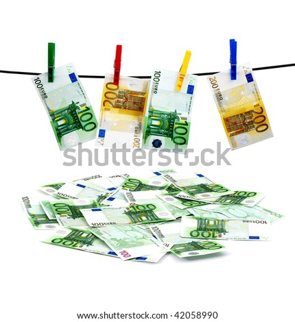 Banknotes drying on a rope after laundry - stock photo