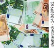 banknotes, euro banknotes spread out on the table - stock photo