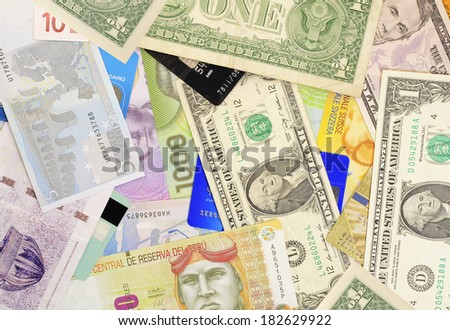 Banknotes of different countries with credit cards.