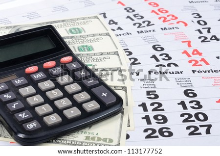 Banknotes of dollar with the calculator close-up - stock photo