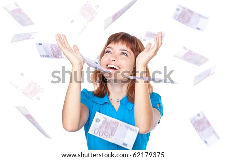 Banknotes of 500 euro are falling on red-haired girl. Isolated on white background