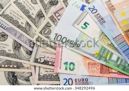 Banknotes of euros above dollars - stock photo