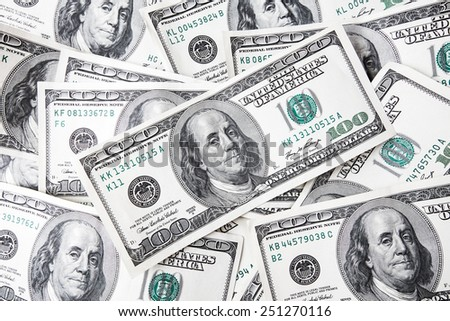 Banknotes of one hundred dollars lying as a background - stock photo