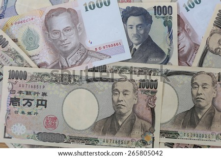 Banknotes of the Japan and Thailand money background.