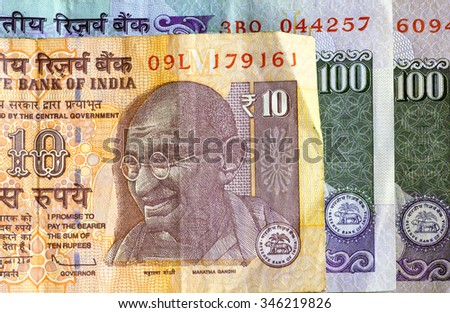 Banknotes of the Republic of India. Selective focus on a portrait of Mahatma Gandhi on the official indian currency.  - stock photo