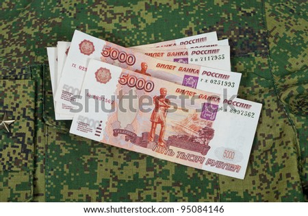 Banknotes on the military uniform - stock photo