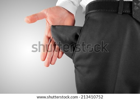 bankrupt business man showing empty pocket  hand - stock photo