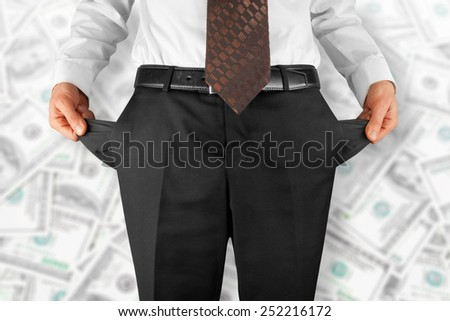 bankrupt business man showing empty pockets  hands - stock photo