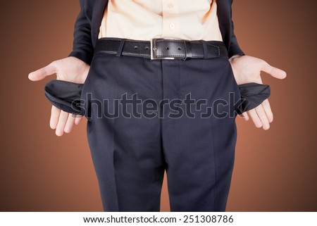bankrupt business man showing empty pockets money from his hands - stock photo