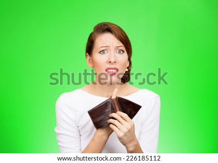 Bankrupt. Portrait sad young unhappy business woman girl holding showing empty wallet isolated on green background. Negative human emotions facial expressions. Financial failure bankruptcy concept - stock photo