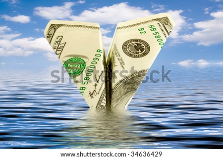 bankruptcy business. money plane crash in water - stock photo