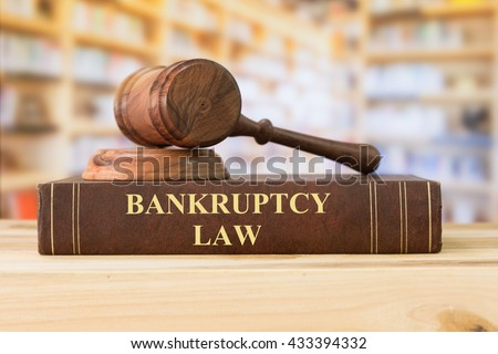 Bankruptcy Law books with a judges gavel on desk in the library. Concept of bankruptcy law,bankrupt,bankruptcy court,law education ,law books. - stock photo