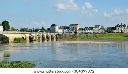 Banks of Vienne river and old bridge, Chinon, France - stock photo