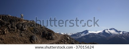 Banner of an Inukshuk at the top of the Peak in Whistler, BC - stock photo