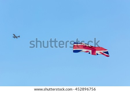 Banner towing, small engine aircraft towing banners for advertising.